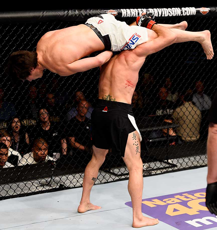 Joshua Burkman attempts to throw down KJ Noons in their bout at UFC Fight Night in Las Vegas.