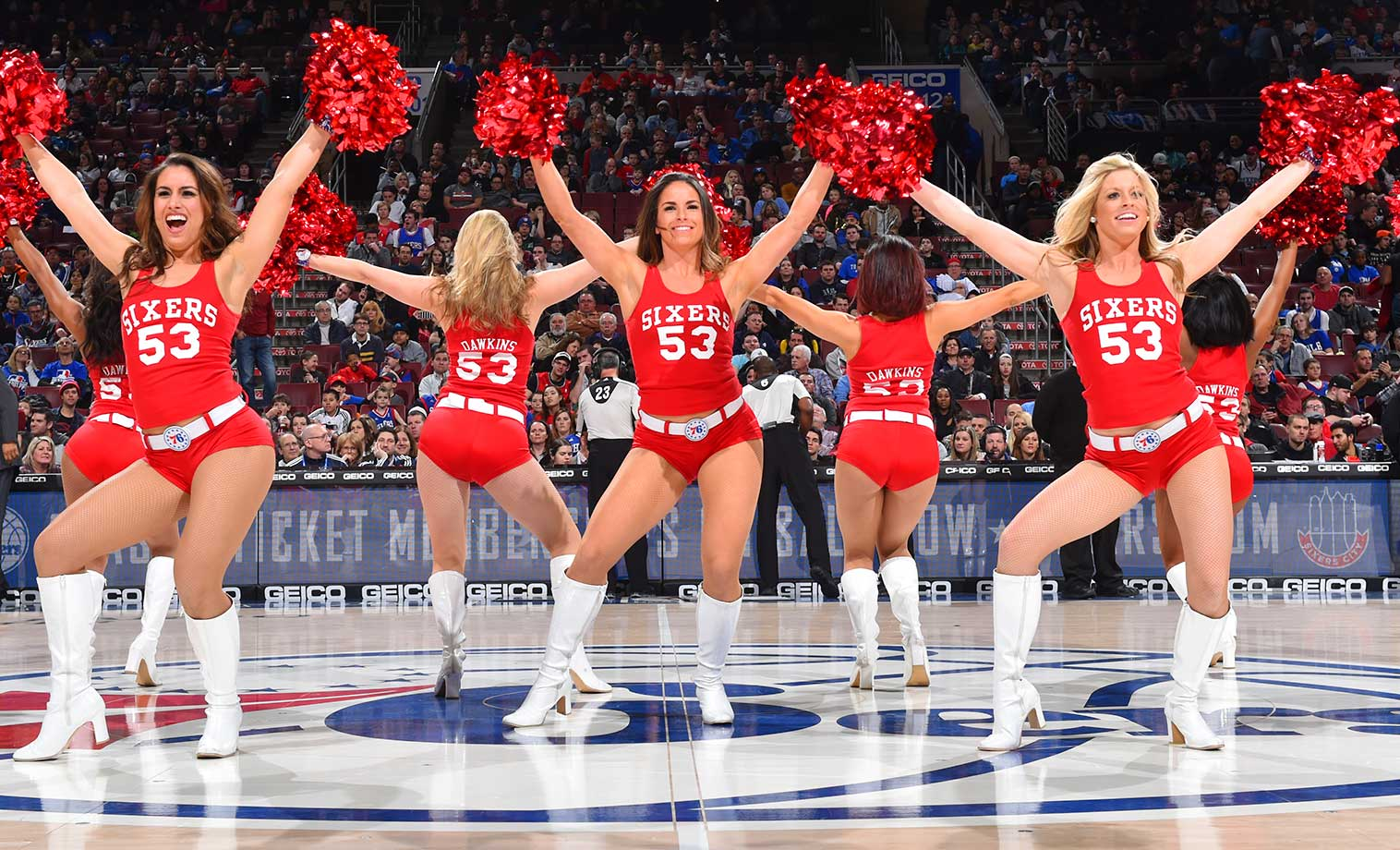 Members of the Philadelphia 76ers dancers perform for the crowd against the Brooklyn Nets.