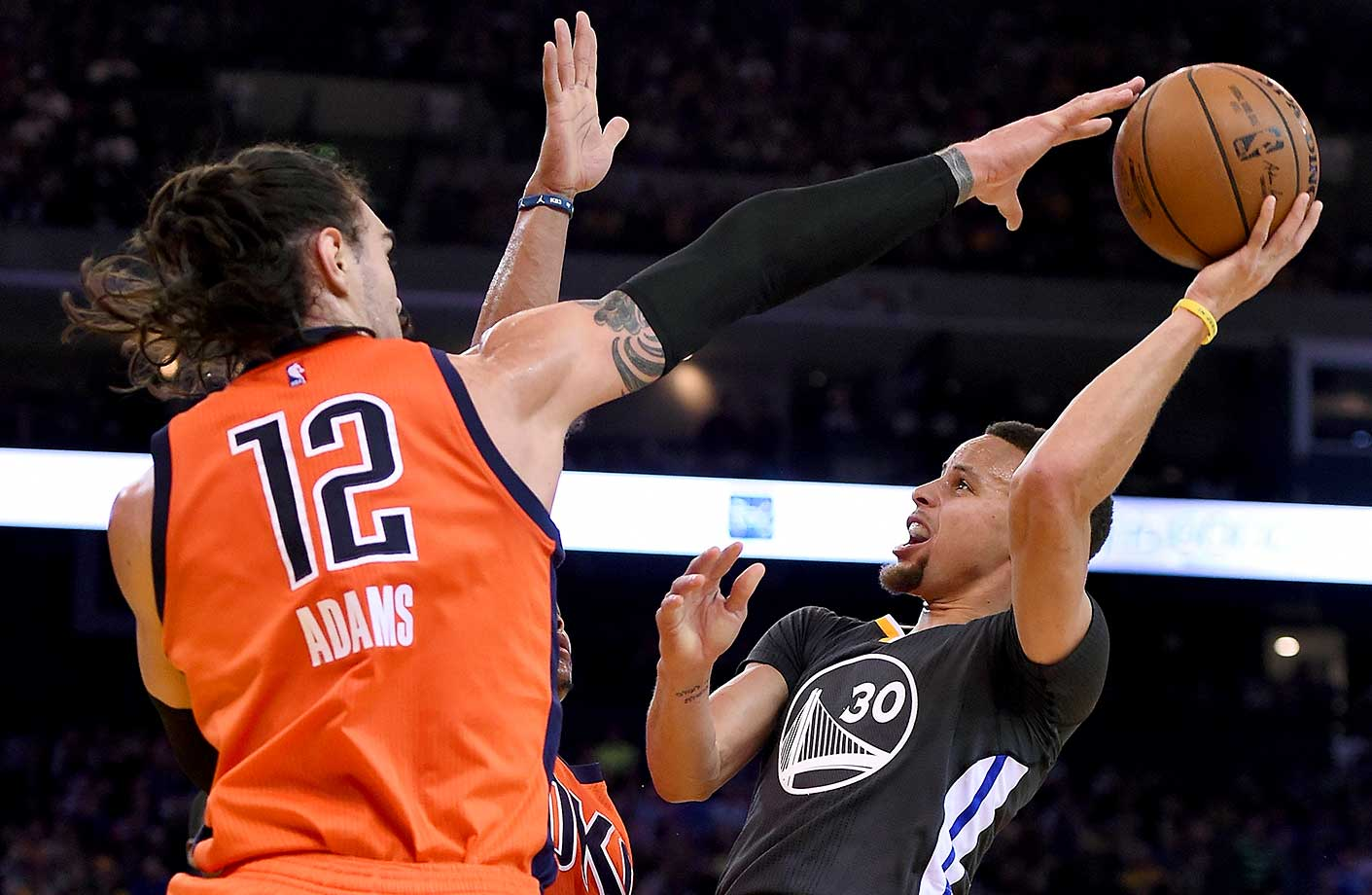 Stephen Curry has his shot blocked by Steven Adams of Oklahoma City during the Warriors home win.