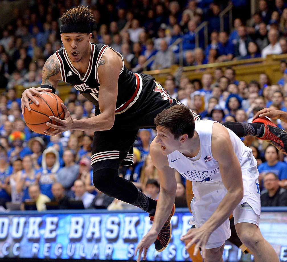 Damion Lee of the Louisville Cardinals collides with Grayson Allen of the Duke Blue Devils as they battle for a rebound.