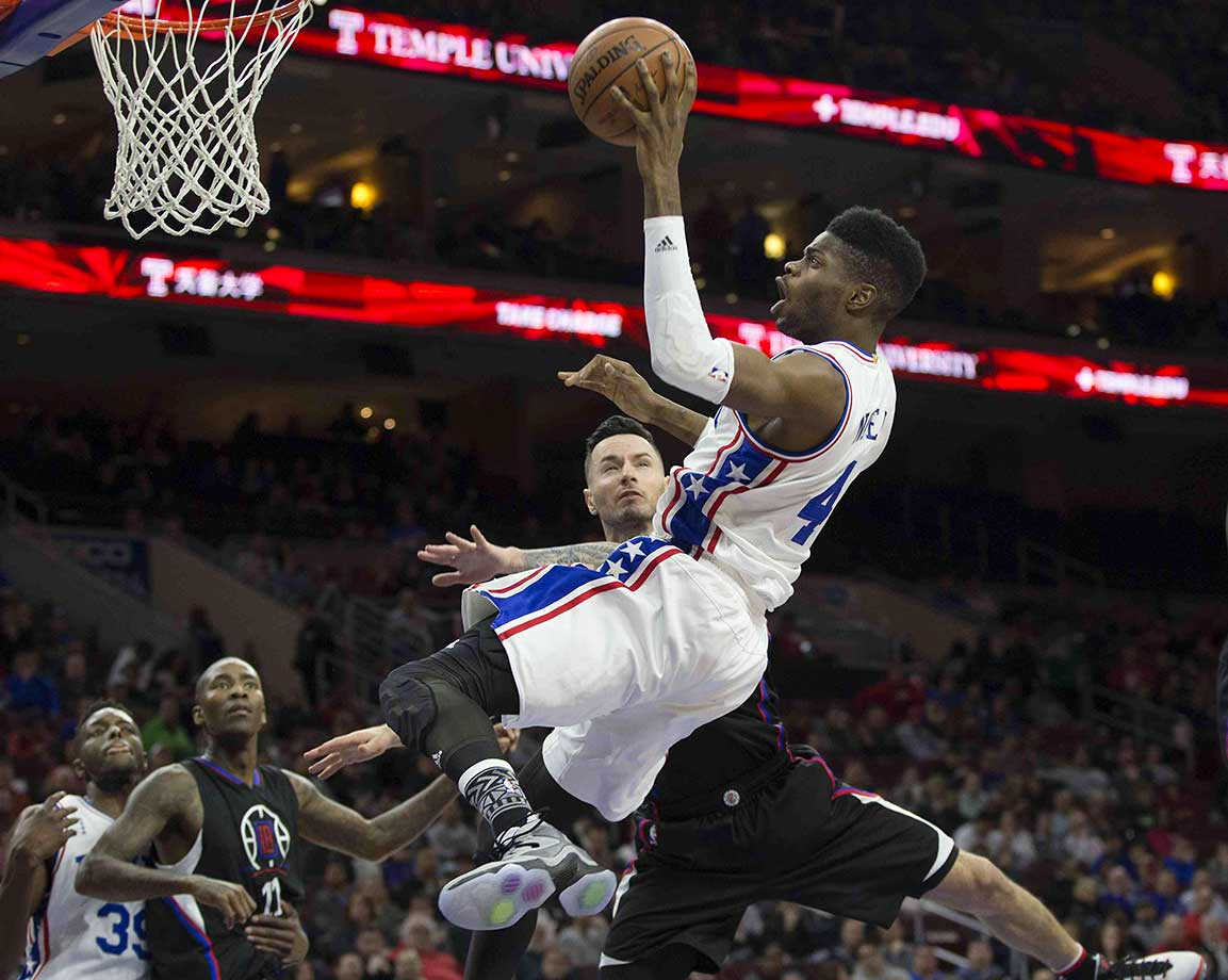 J.J Redick of the Clippers fouls Nerlens Noel of the Philadelphia 76ers.