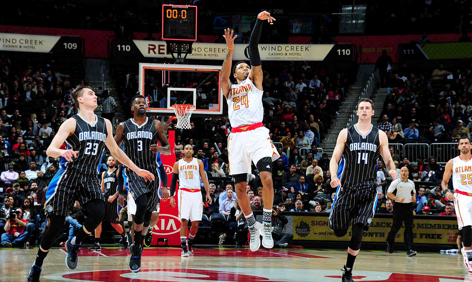 Kent Bazemore shoots from long distance against the Orlando Magic, trying to beat the clock.