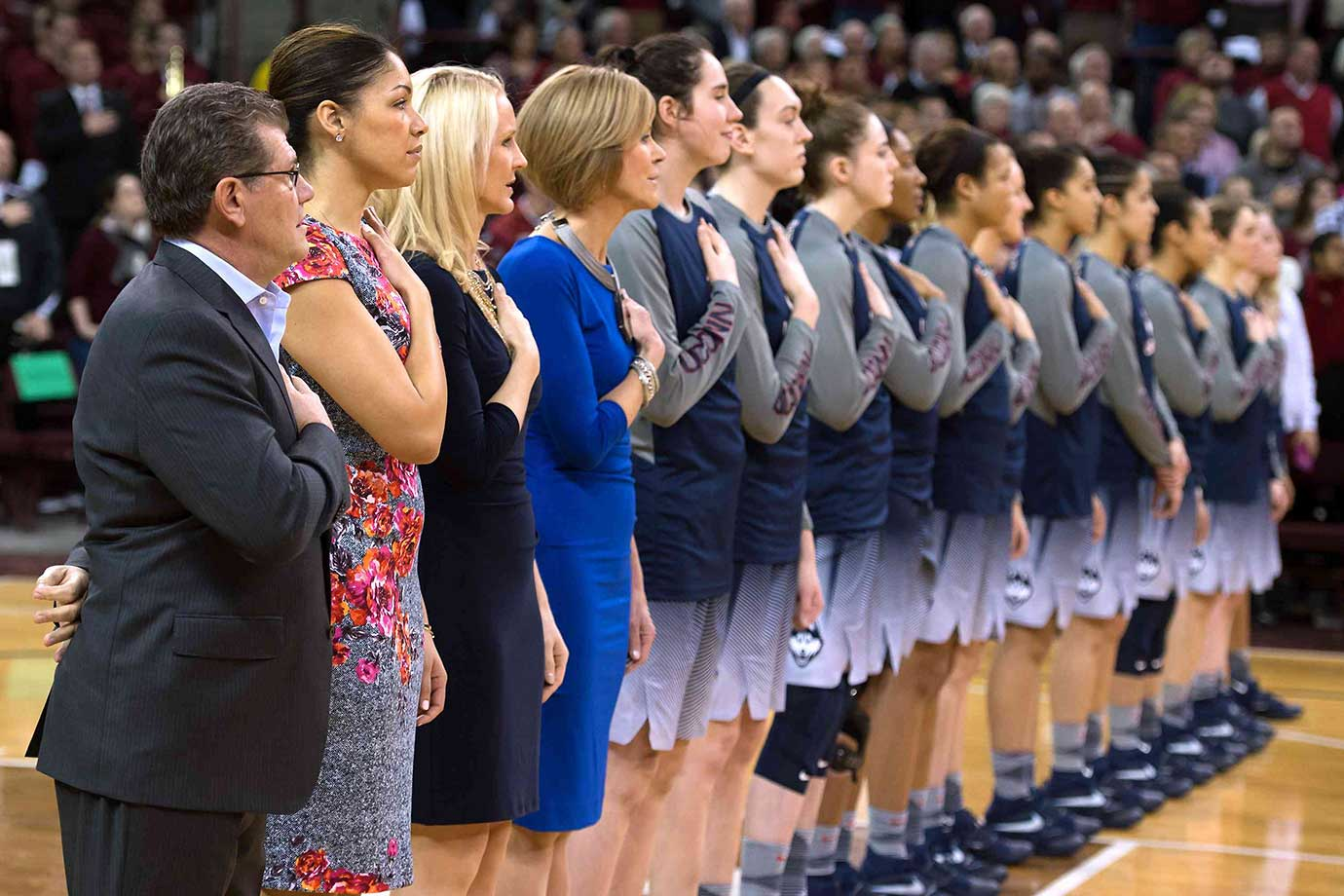 Coaches and players of the Connecticut Huskies stand during the National Anthem prior to their game at South Carolina.