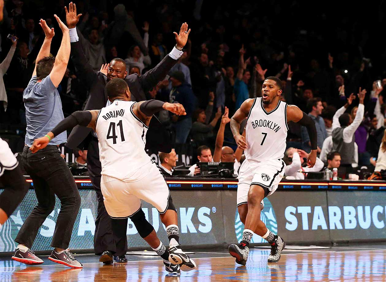 Joe Johnson of the Brooklyn Nets celebrates after hitting the game-winnin, three-pointer in the final second to beat Denver.