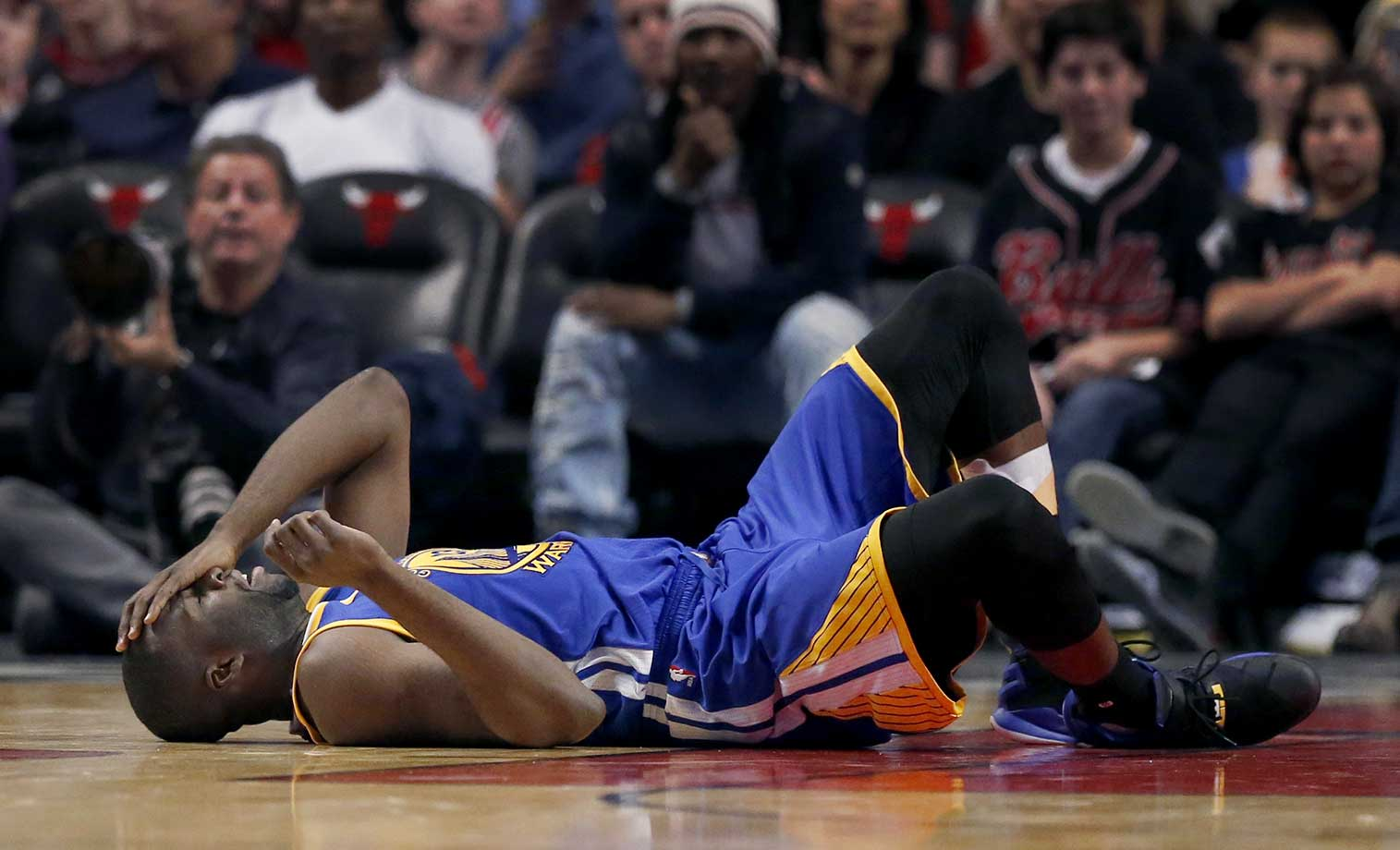Golden State Warriors forward Draymond Green lays on the court after getting struck by Chicago Bulls forward Taj Gibson in Chicago. The Warriors won 125-94.