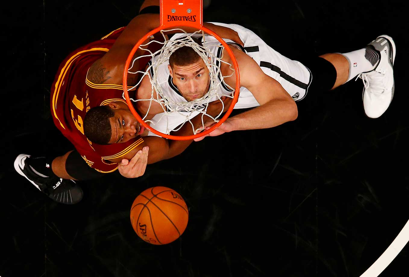 Brook Lopez of the Brooklyn Nets battles Tristan Thompson of the Cleveland Cavaliers for the ball during their game at the Barclays Center.
