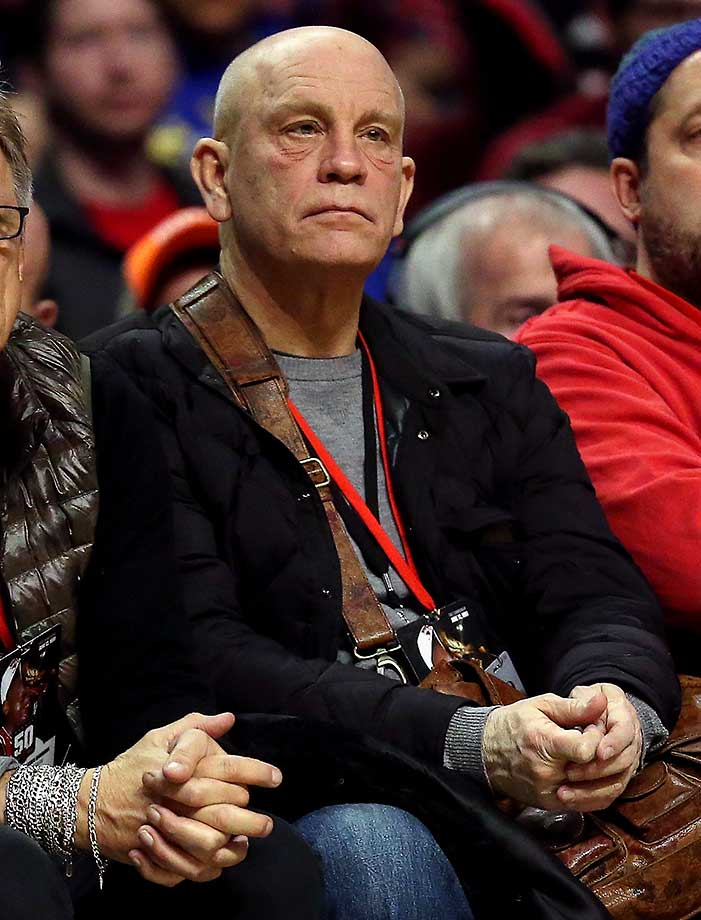 Actor John Malkovich sits courtside as the Chicago Bulls take on the Golden State Warriors at the United Center. The Warriors defeated the Bulls 125-94.