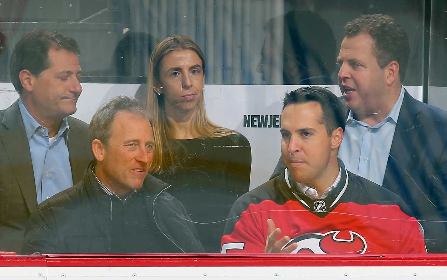 New Jersey Devils owner Josh Harris takes in the game against the Ottawa Senators with Mark Teixeira of the New York Yankees.