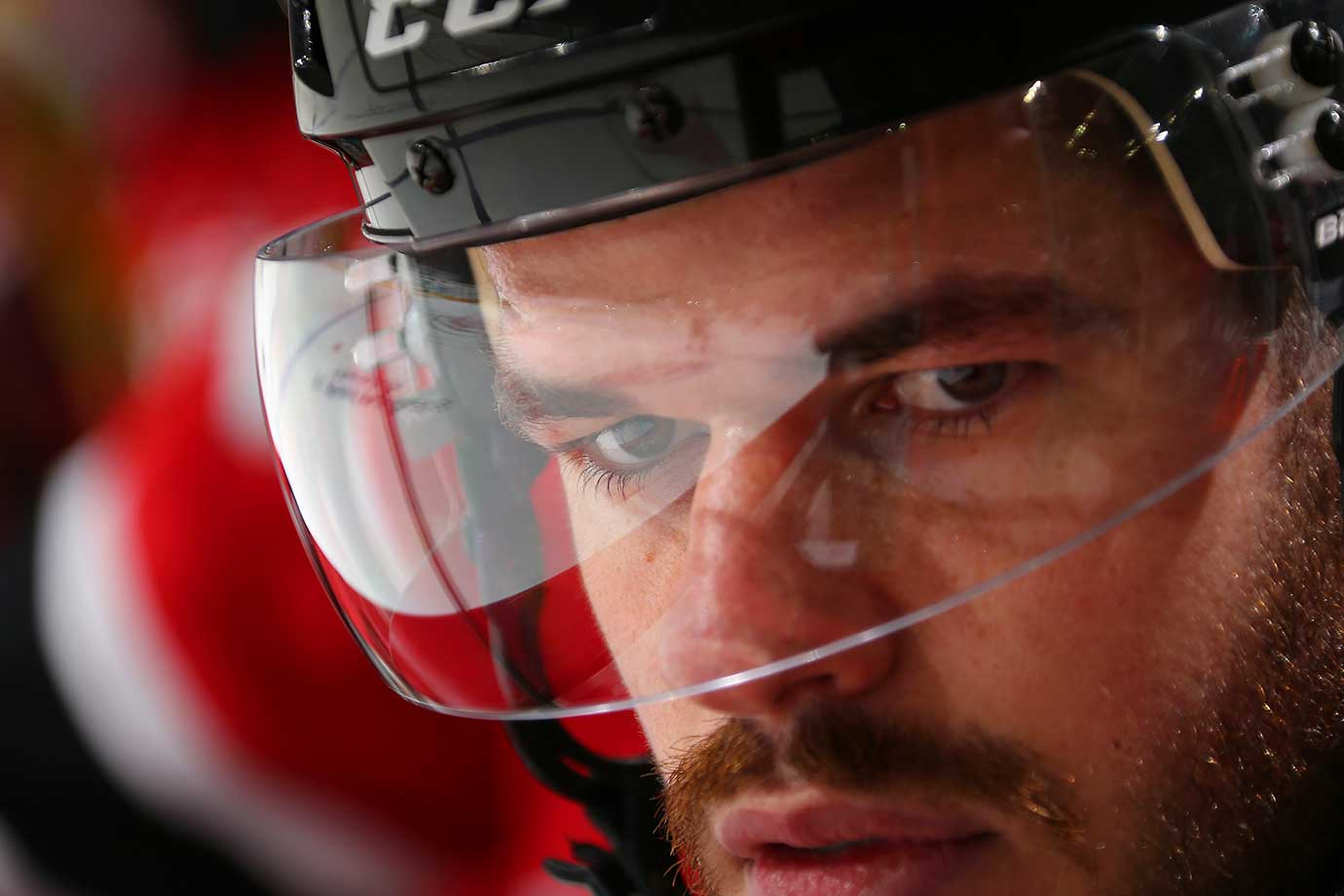 Eric Gelinas of the New Jersey Devils watches the action from the bench against the Ottawa Senators in Newark.