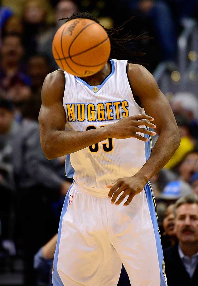Nuggets forward Kenneth Faried makes a pass at the Pepsi Center in Denver.