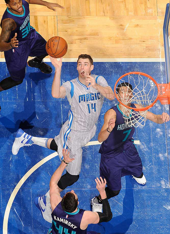 Jason Smith of the Orlando Magic goes up for a rebound against the Charlotte Hornets at Amway Center in Orlando.