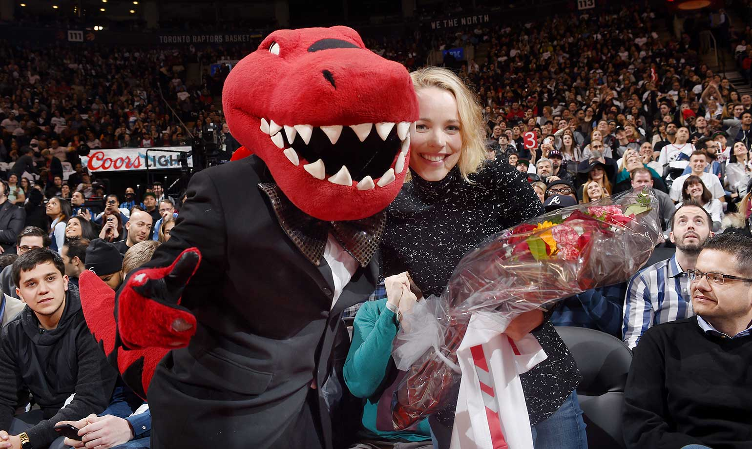The Toronto Raptors mascot poses with actress Rachael McAdams during the game against the Miami Heat.