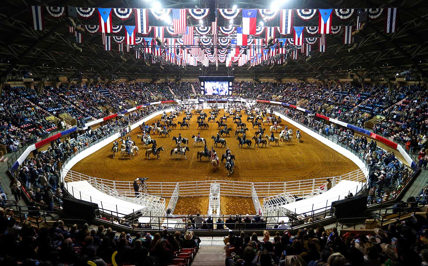 Riders participate in the Grand Entry at the Fort Worth Stock Show and Rodeo in Fort Worth.