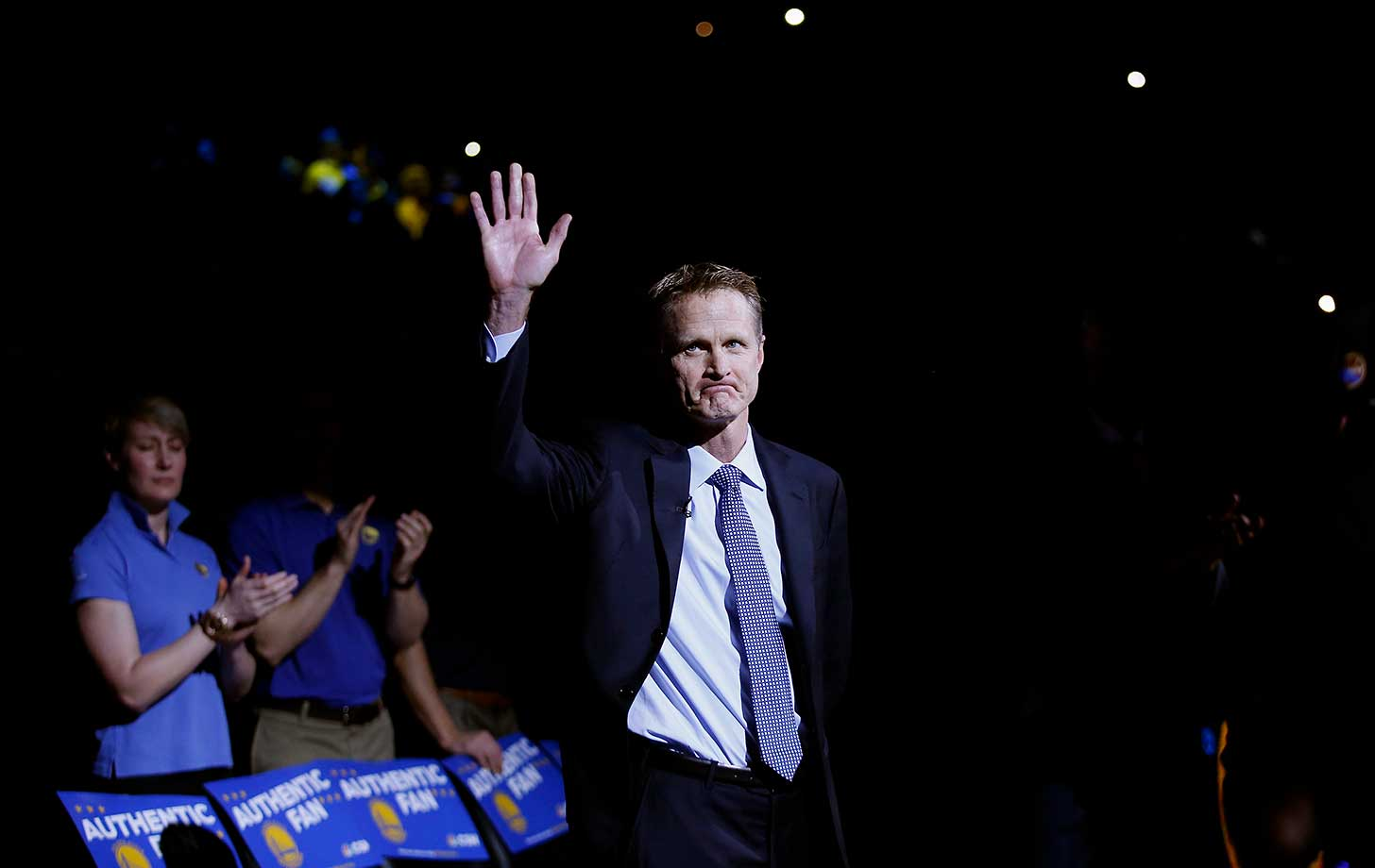 Head coach Steve Kerr waves to the crowd before his first game of the season. The Warriors coach had been out since Oct. 1 with complications following two back surgeries.