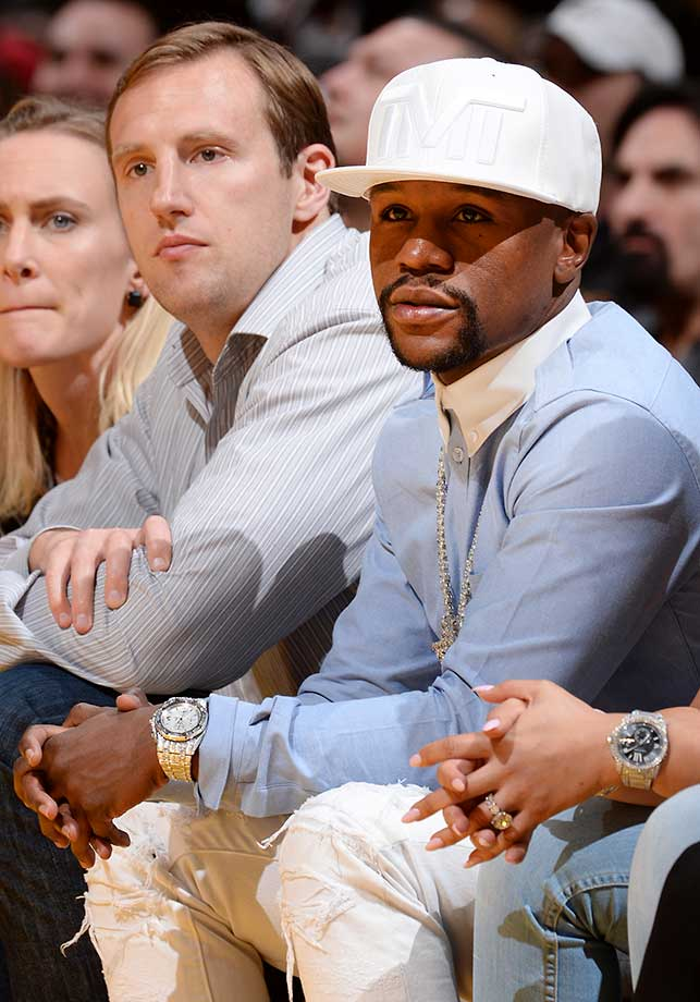 Professional boxer Floyd Mayweather attends the Los Angeles Lakers game against the San Antonio Spurs in Los Angeles.