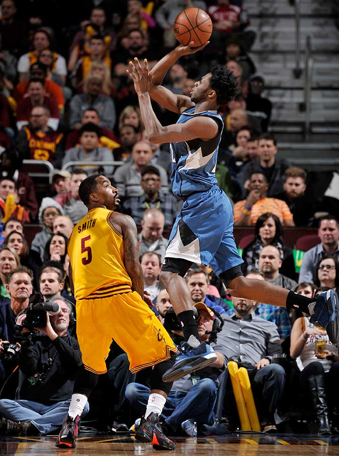 Andrew Wiggins of the Minnesota Timberwolves shoots against J.R. Smith of the Cleveland Cavaliers at Quicken Loans Arena in Ohio.