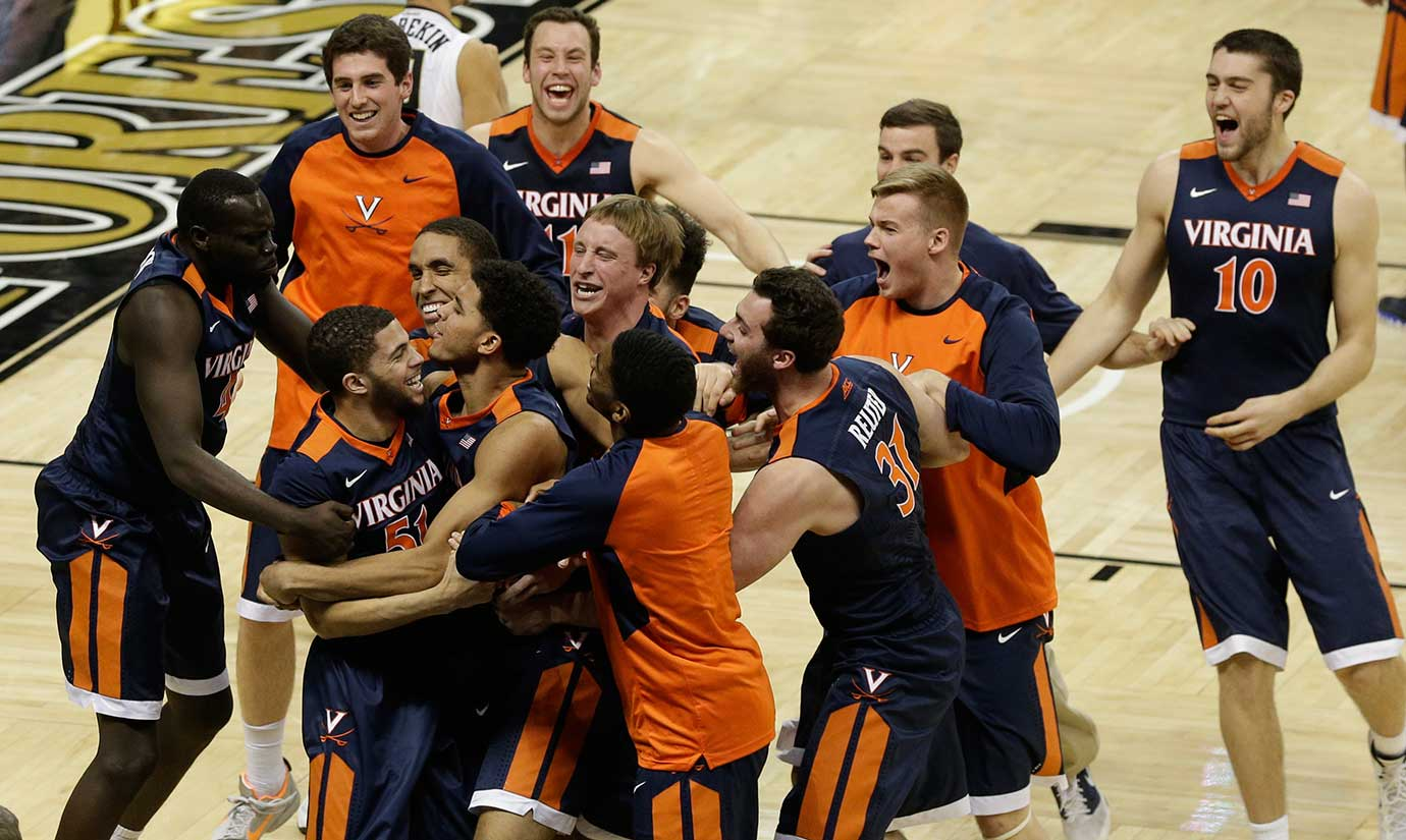 Virginia players celebrate with teammate Darius Thompson (51) after his buzzer-beating shot against Wake Forest in Winston-Salem, N.C. Virginia won 72-71.