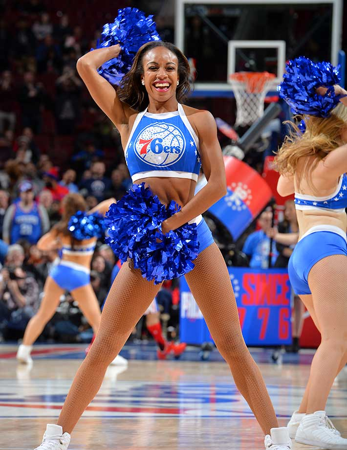 A member of the Philadelphia 76ers dance team performs for the crowd against the Phoenix Suns at Wells Fargo Center in Philadelphia.