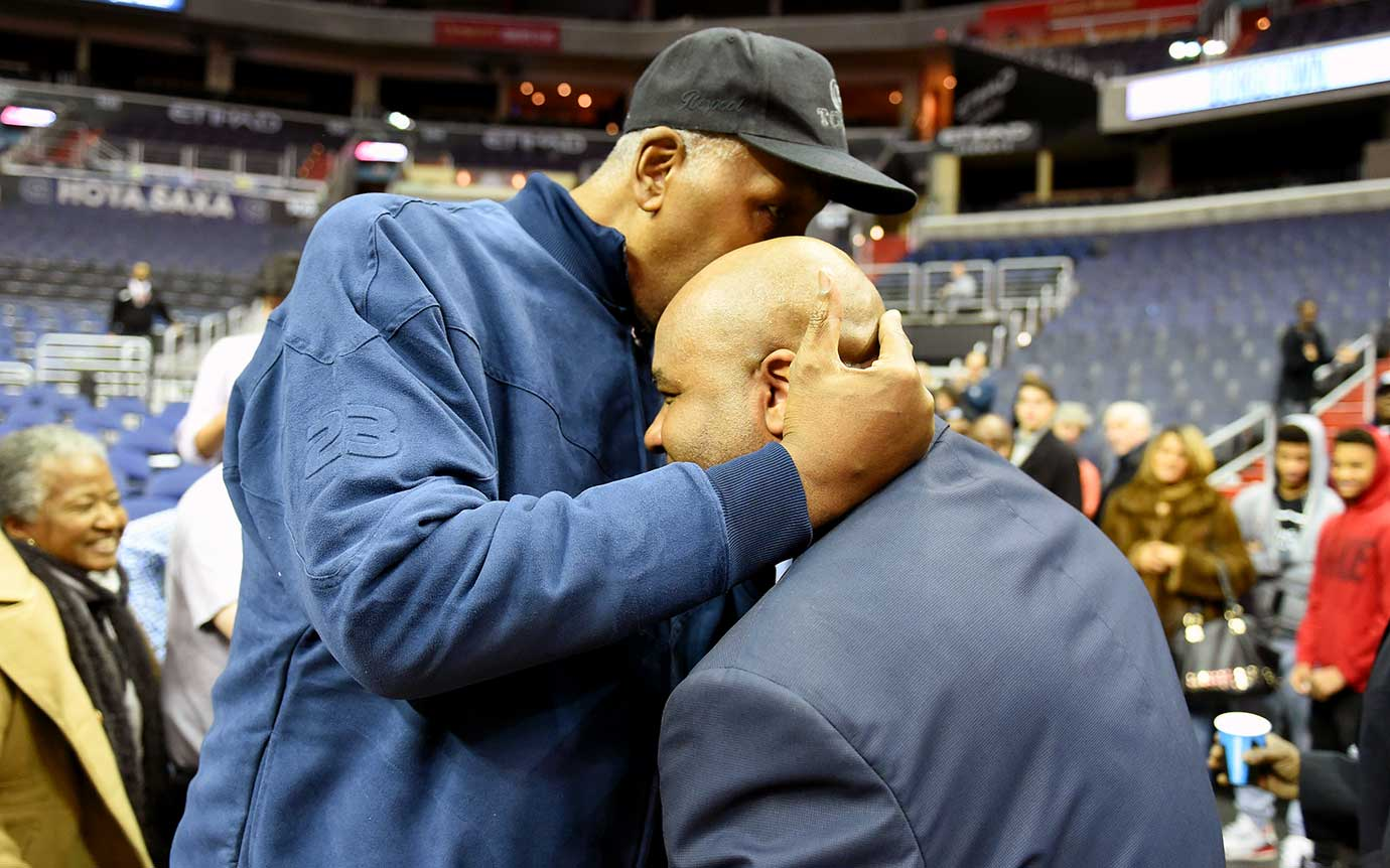 Head coach John Thompson III of the Georgetown Hoyas gets a hug from his dad, John Thompson Jr., after a win over the Creighton Bluejays at the Verizon Center in Washington, D.C.