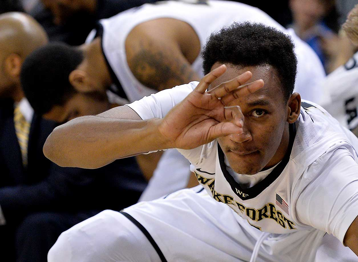 Greg McClinton of the Wake Forest Demon Deacons reacts after a teammate's three-point basket against the Virginia Cavaliers at LJVM Coliseum Complex in Winston-Salem, N.C.