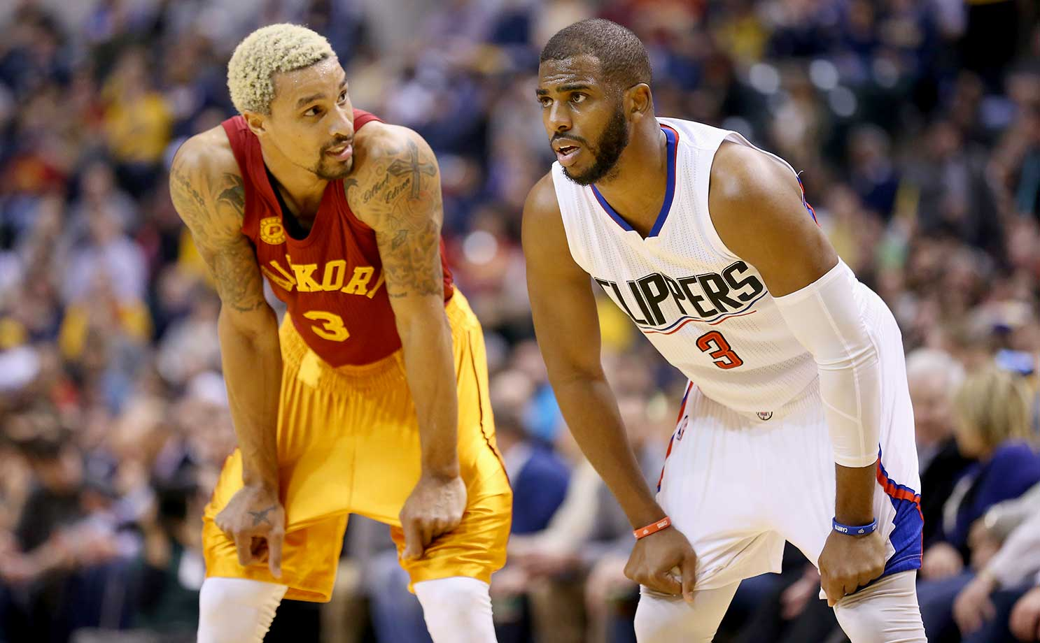 Chris Paul of the Los Angeles Clippers and George Hill of the Indiana Pacers during Tuesday's game at Bankers Life Fieldhouse in Indianapolis, Ind.