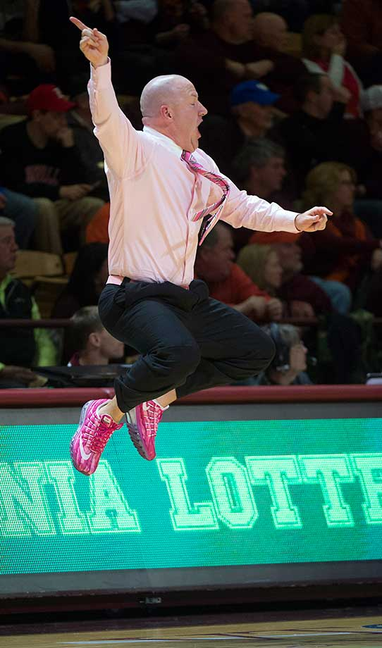Virginia Tech coach Buzz Williams, wearing pink shoes, shirt and tie for breast cancer awareness, yells to his team during a 91-83 loss to Louisville in Blacksburg, Va.