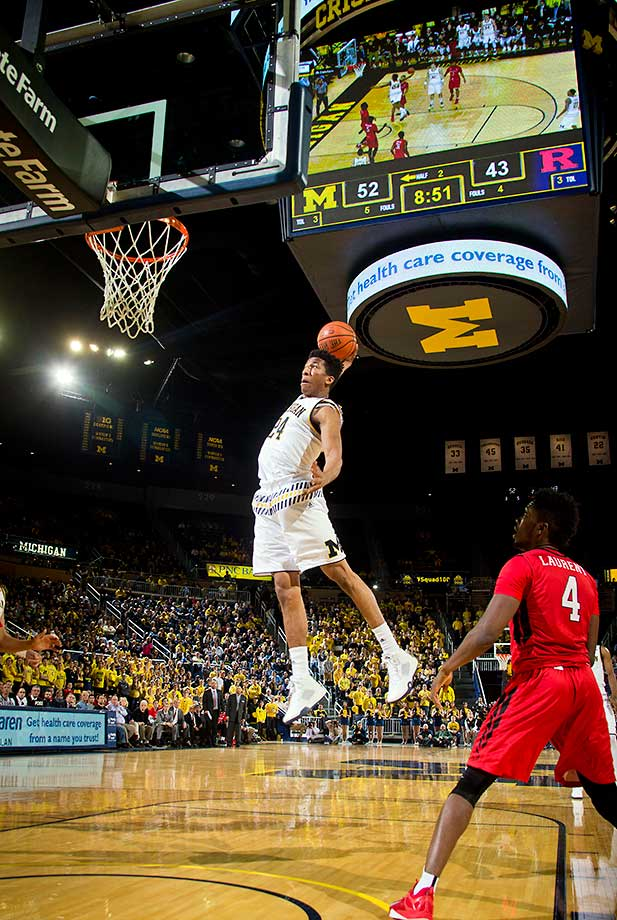 Michigan guard Aubrey Dawkins attempts to make a slam dunk against Rutgers at Crisler Center in Ann Arbor, Mich. Even though Dawkins' attempt rebounded off the rim and back towards the court, the Wolverines won 68-57.
