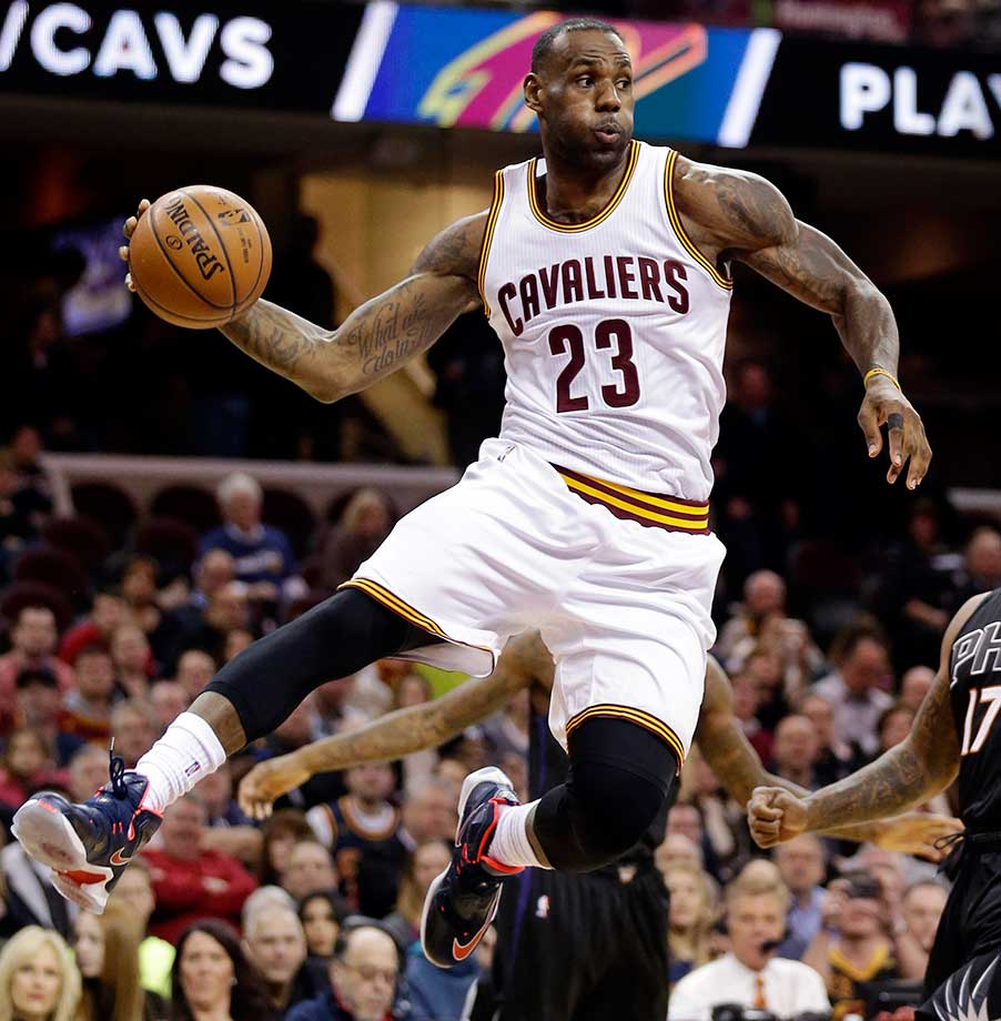 LeBron James looks to pass against the Phoenix Suns  in Cleveland.