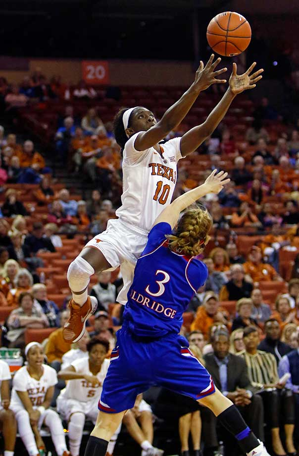 Texas guard Lashann Higgs reaches for a pass against Kansas guard Lauren Aldridge in Austin.  Texas won 70-46.