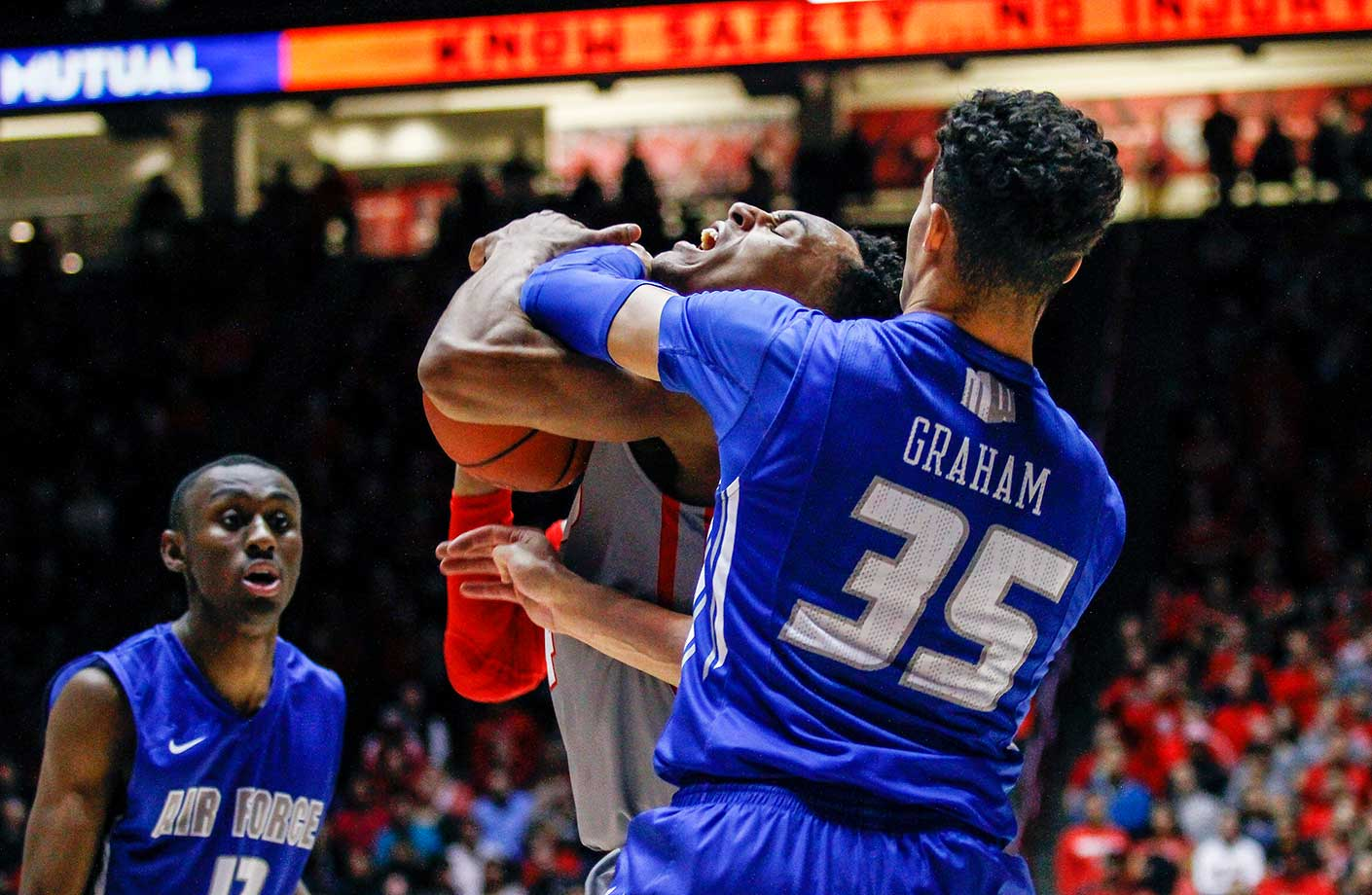 New Mexico's Elijah Brown is fouled by Air Force's Hayden Graham in Albuquerque. New Mexico routed Air Force 84-55.