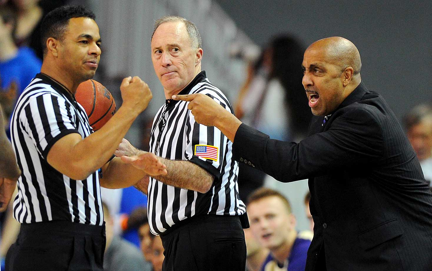 Washington head coach Lorenzo Romar has words with officials in a game against UCLA in Los Angeles.
