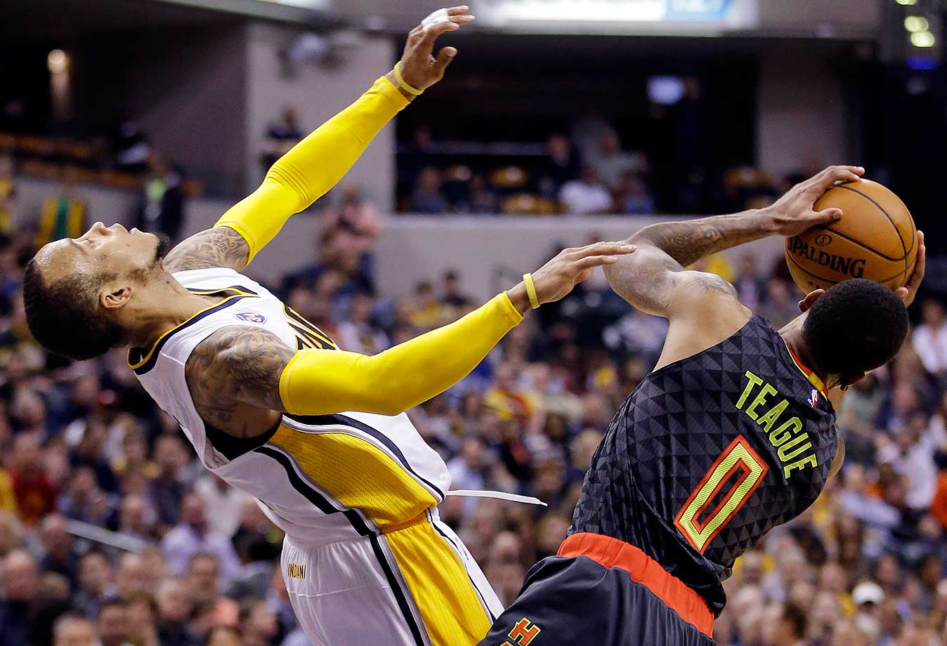 Atlanta Hawks' Jeff Teague is called for a charging foul against Indiana Pacers' Monta Ellis in Indianapolis. Indiana won 111-92.