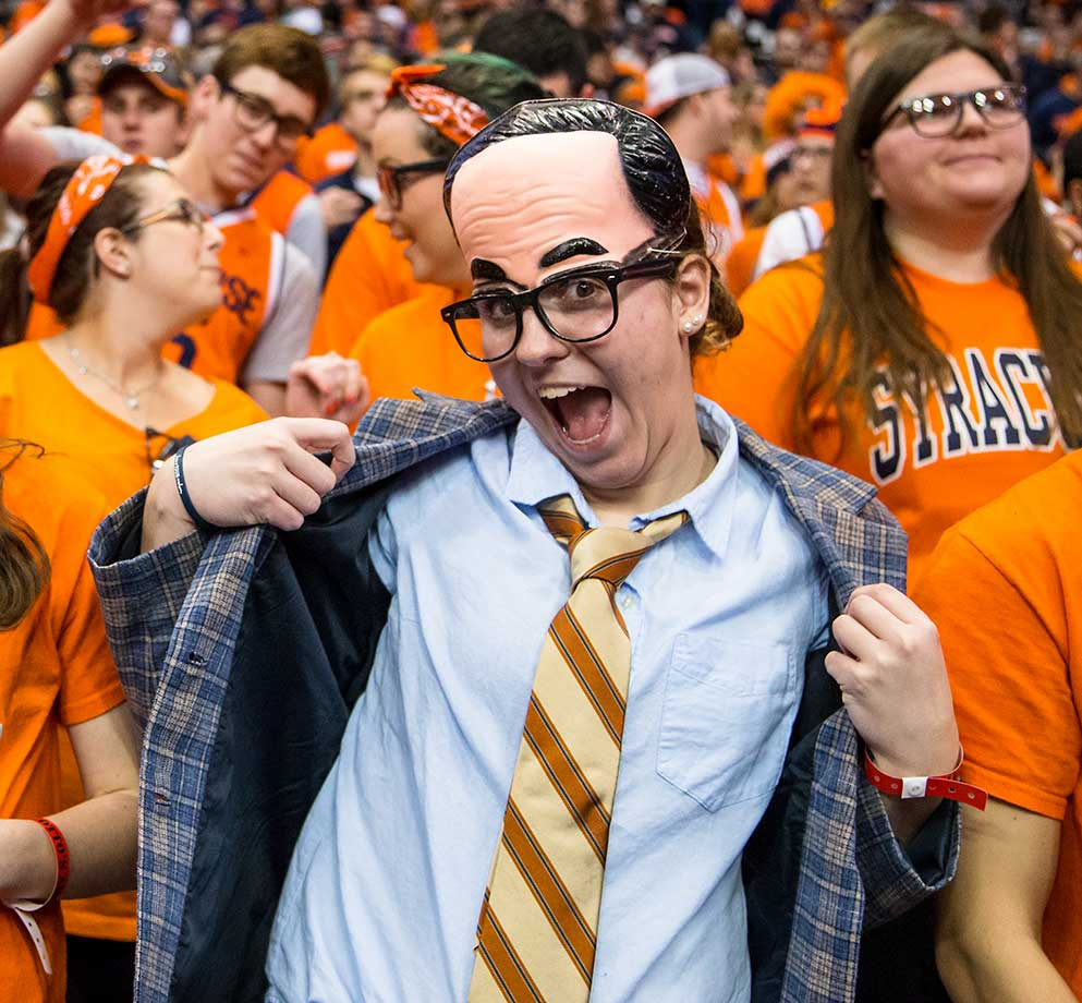 Syracuse Orange fans participate in dressing like head coach Jim Boeheimbefore the game against the Notre Dame Fighting Irish at The Carrier Dome in New York.