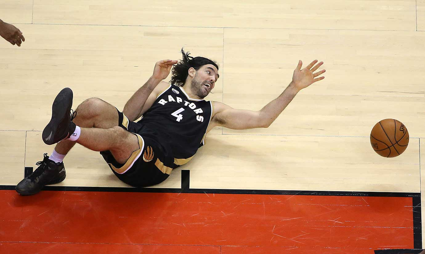 Luis Scola loses the ball as he falls as the Toronto Raptors play the New York Knicks  at the  Air Canada Centre in Toronto.