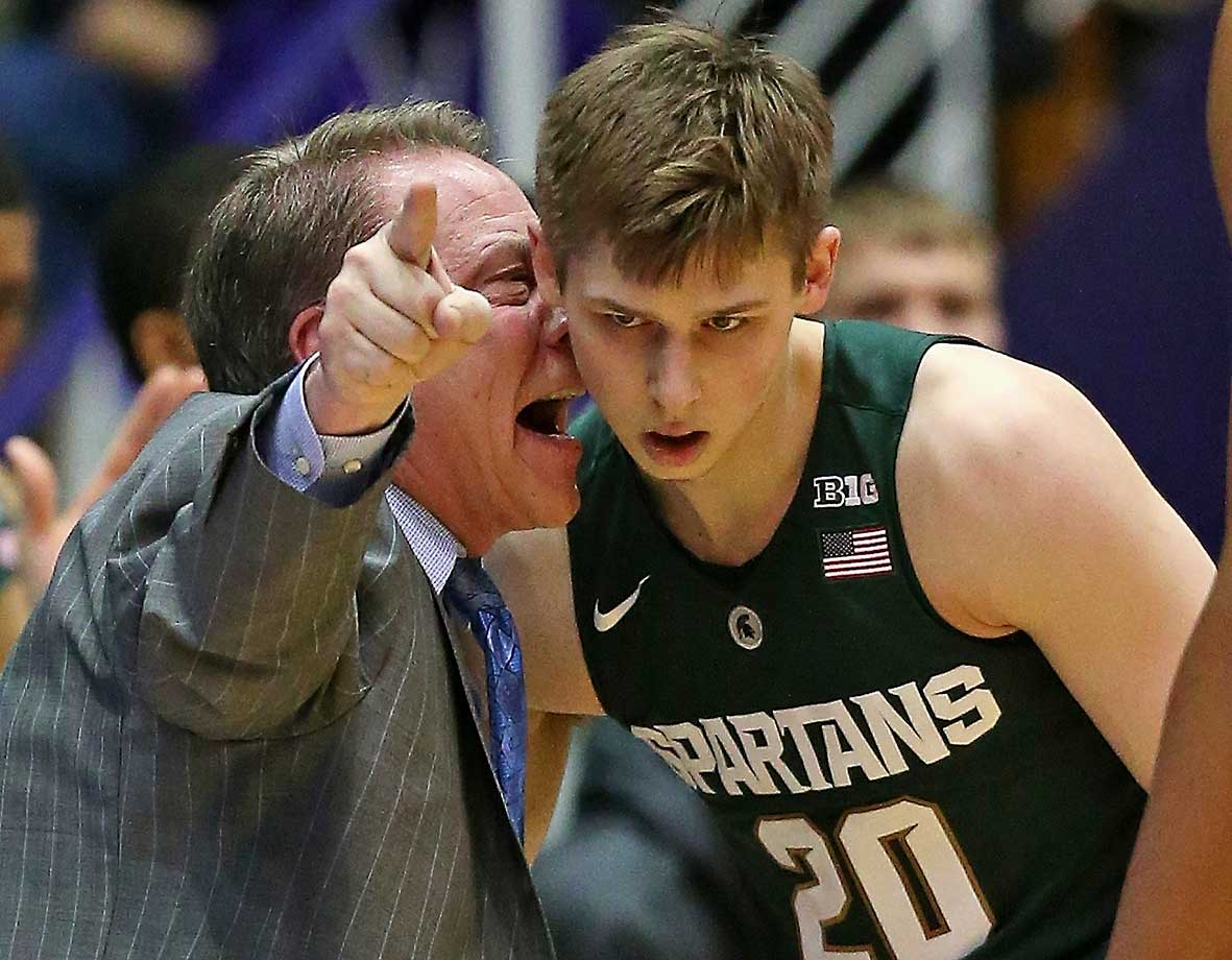 Michigan State coach Tom Izzo giving Matt McQuaid an earful, though McQuaid doesn't seem to realize Izzo is yelling.