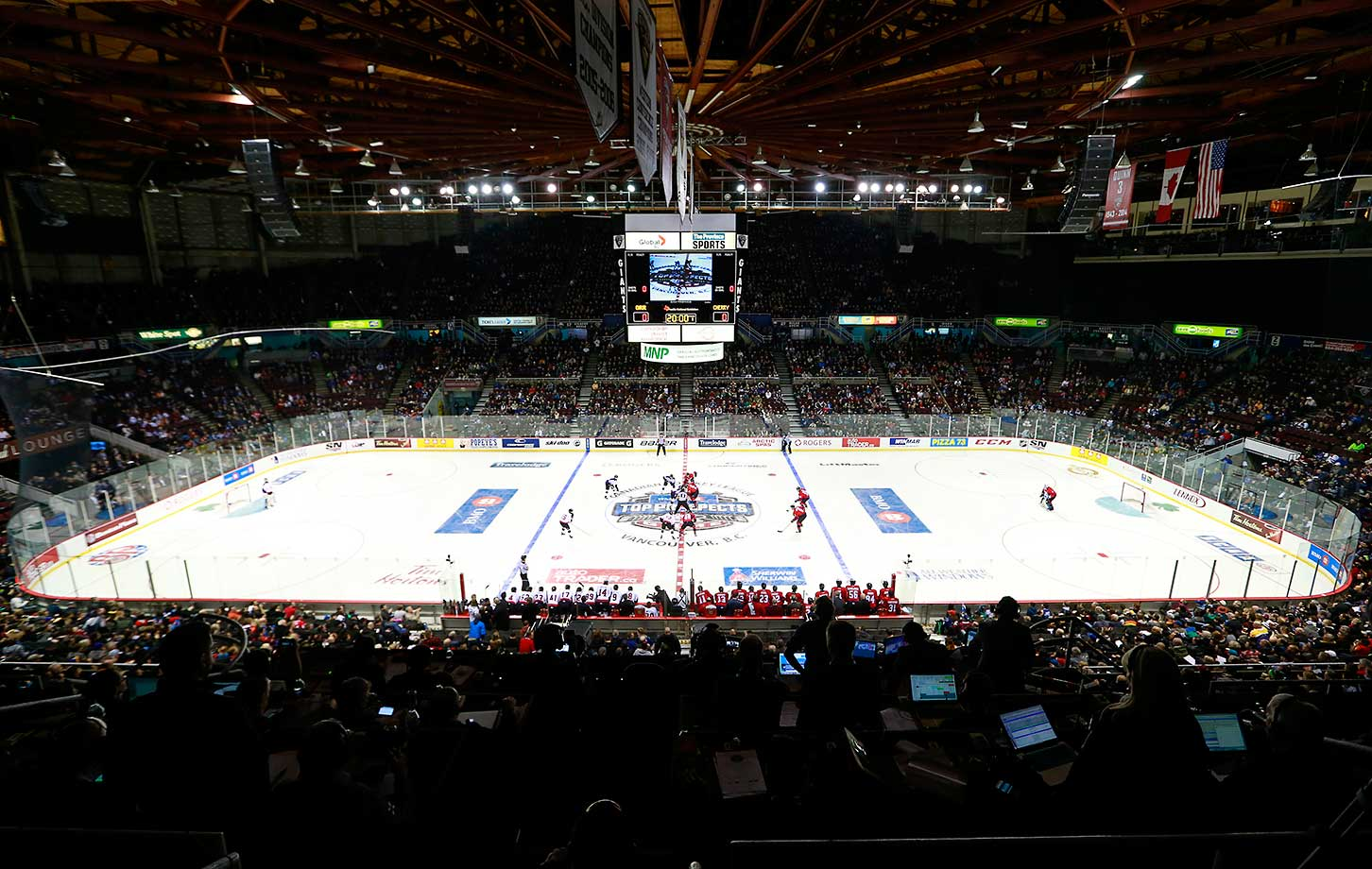 Team Cherry  and Team Orr faceoff at the start of the CHL/NHL Top Prospects Game at Pacific Coliseum in Vancouver.