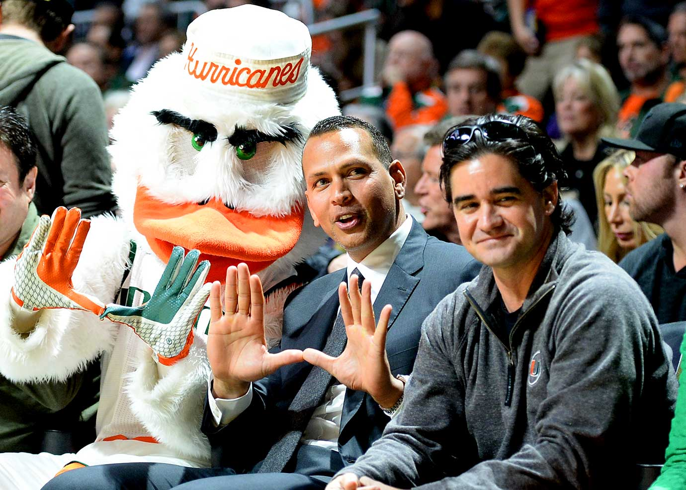 Here are some of the images that caught our eye on the sports night of Jan. 25, beginning with Alex Rodriguez sitting courtside at the Miami vs. Duke game and flashing the U sign with the Hurricanes mascot. Miami defeated Duke 80 to 69.