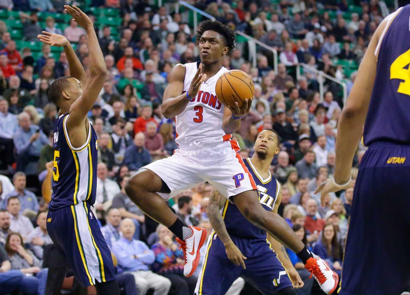 Detroit Pistons forward Stanley Johnson goes to the basket as Utah Jazz's Rodney Hood defends in Salt Lake City.