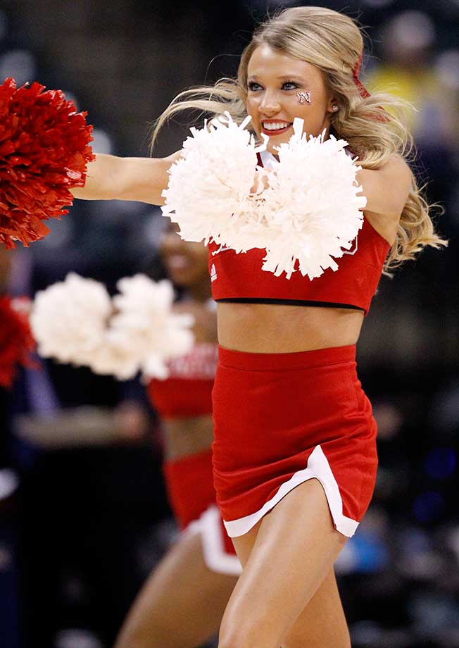 A Nebraska cheerleader performs during the Cornhuskers game against Rutgers.