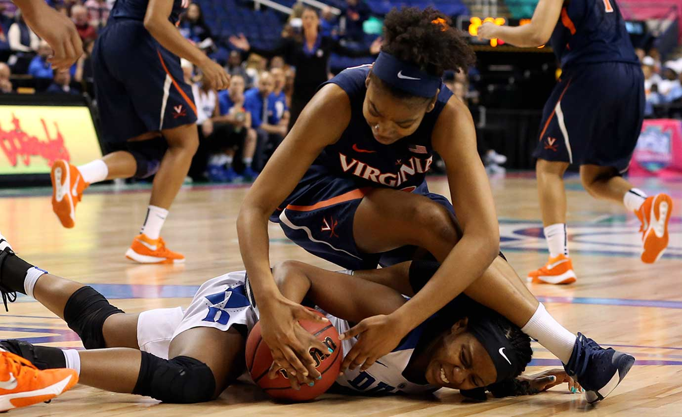Virginia's Mone Jones lands on Duke's Kyra Lambert while competing for a loose ball.