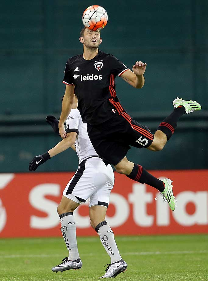 Steven Birnbaum of DC United heads away during a CONCACAF Champions League quarterfinal match at RFK Stadium.