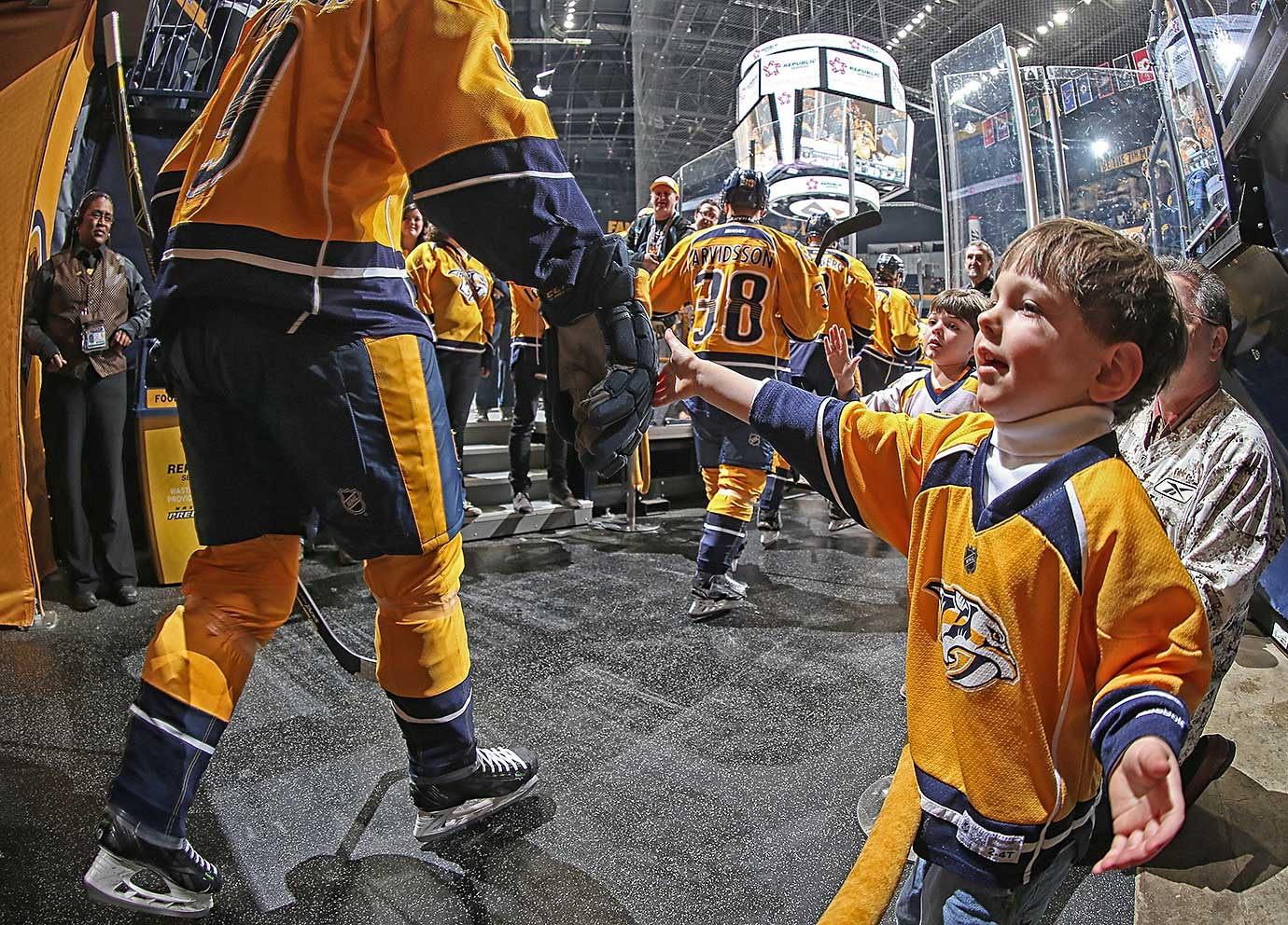 A young fan taps the glove of Filip Forsberg of the Nashville Predators prior to a game against Dallas.