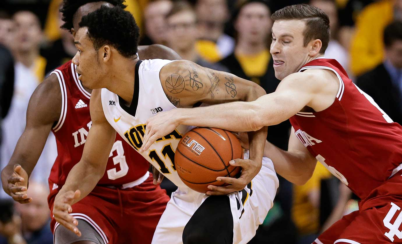 Indiana guard Harrison Niego tries to steal the ball from Iowa guard Christian Williams.