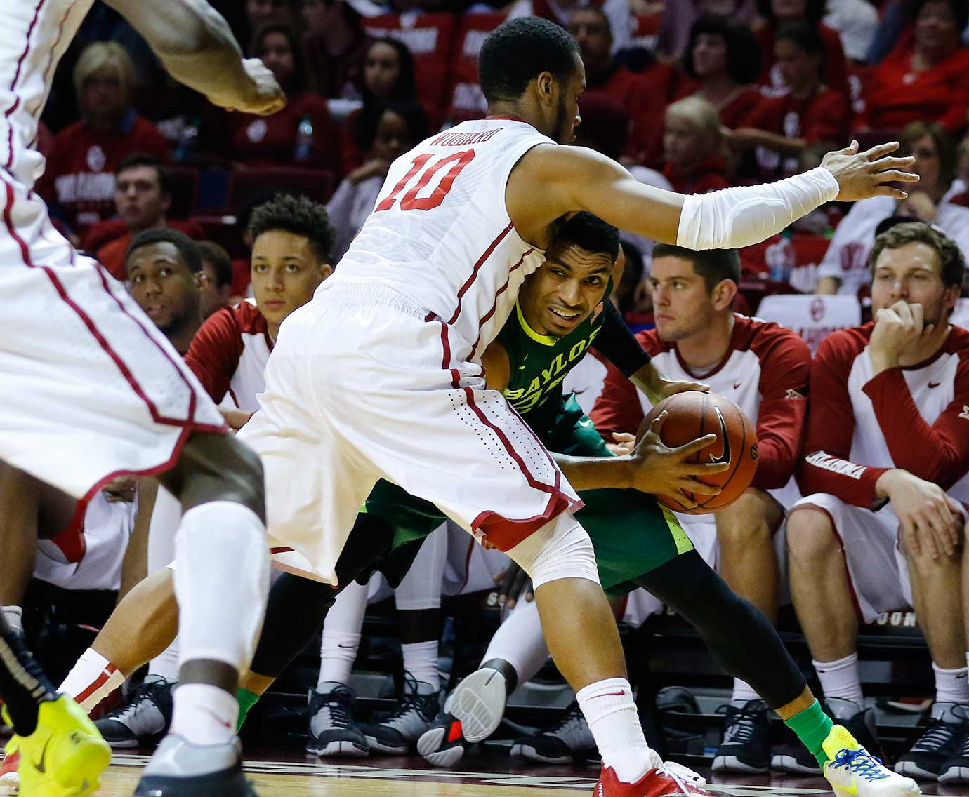 Baylor guard Al Freeman attempts to turn the corner on Oklahoma guard Jordan Woodard.