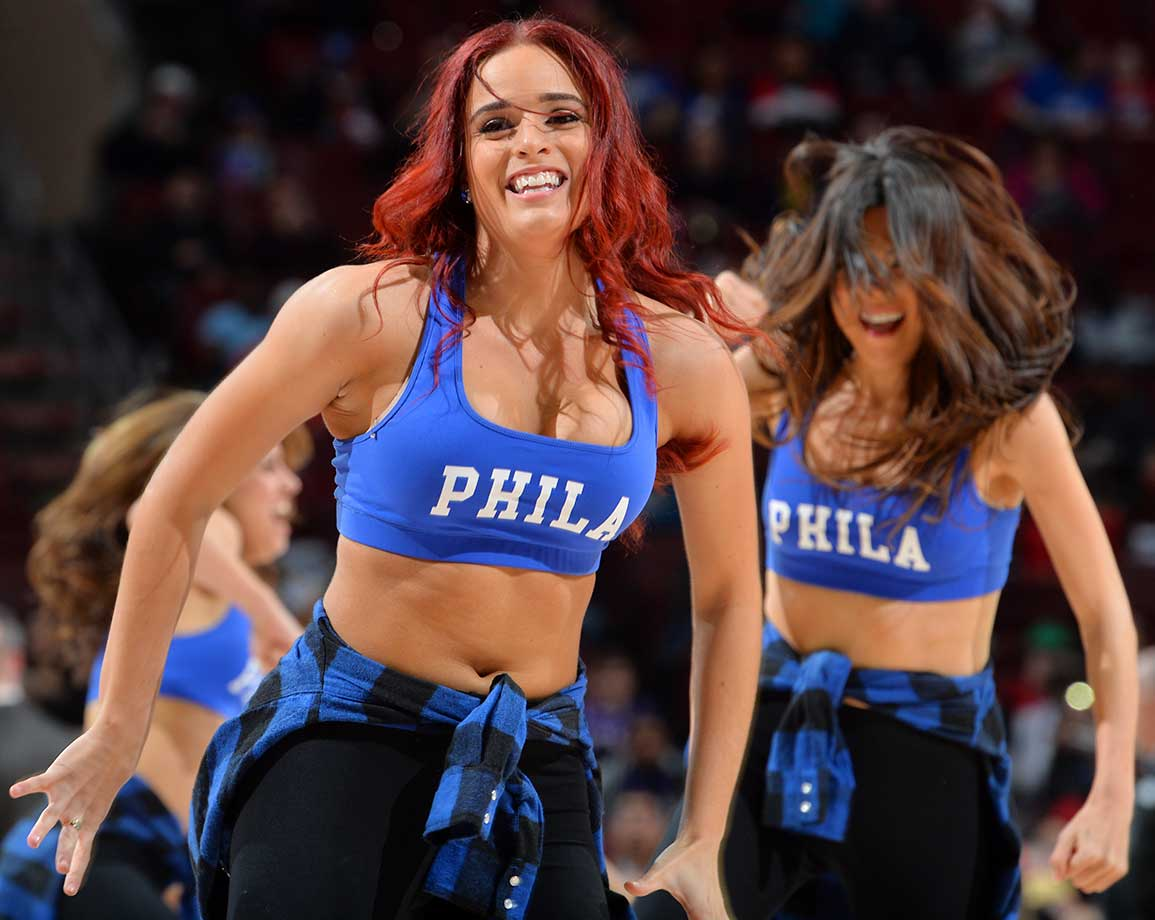 Dancers of the Philadelphia 76ers look on against the Charlotte Hornets.