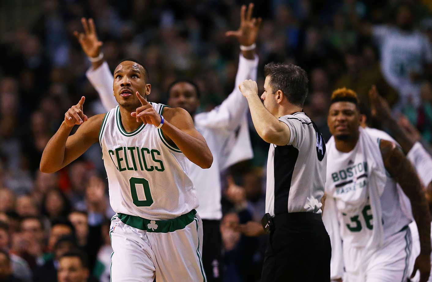 Avery Bradley of the Boston Celtics celebrates after hitting a three-point shot against Portland.
