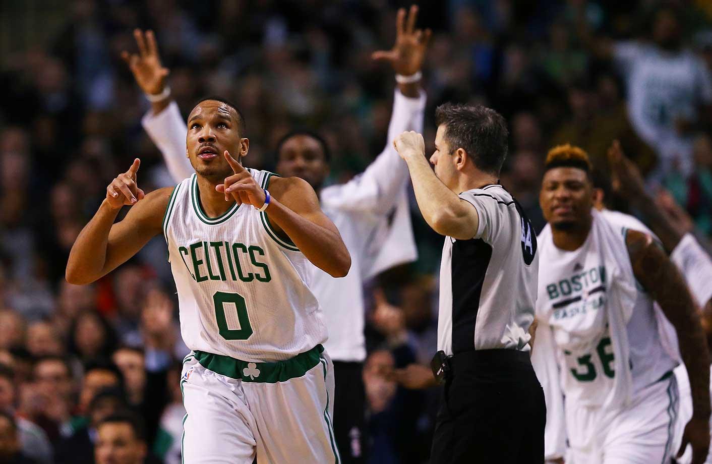 Avery Bradley of the Boston Celtics celebrates after hitting a three-point shot against Portland.