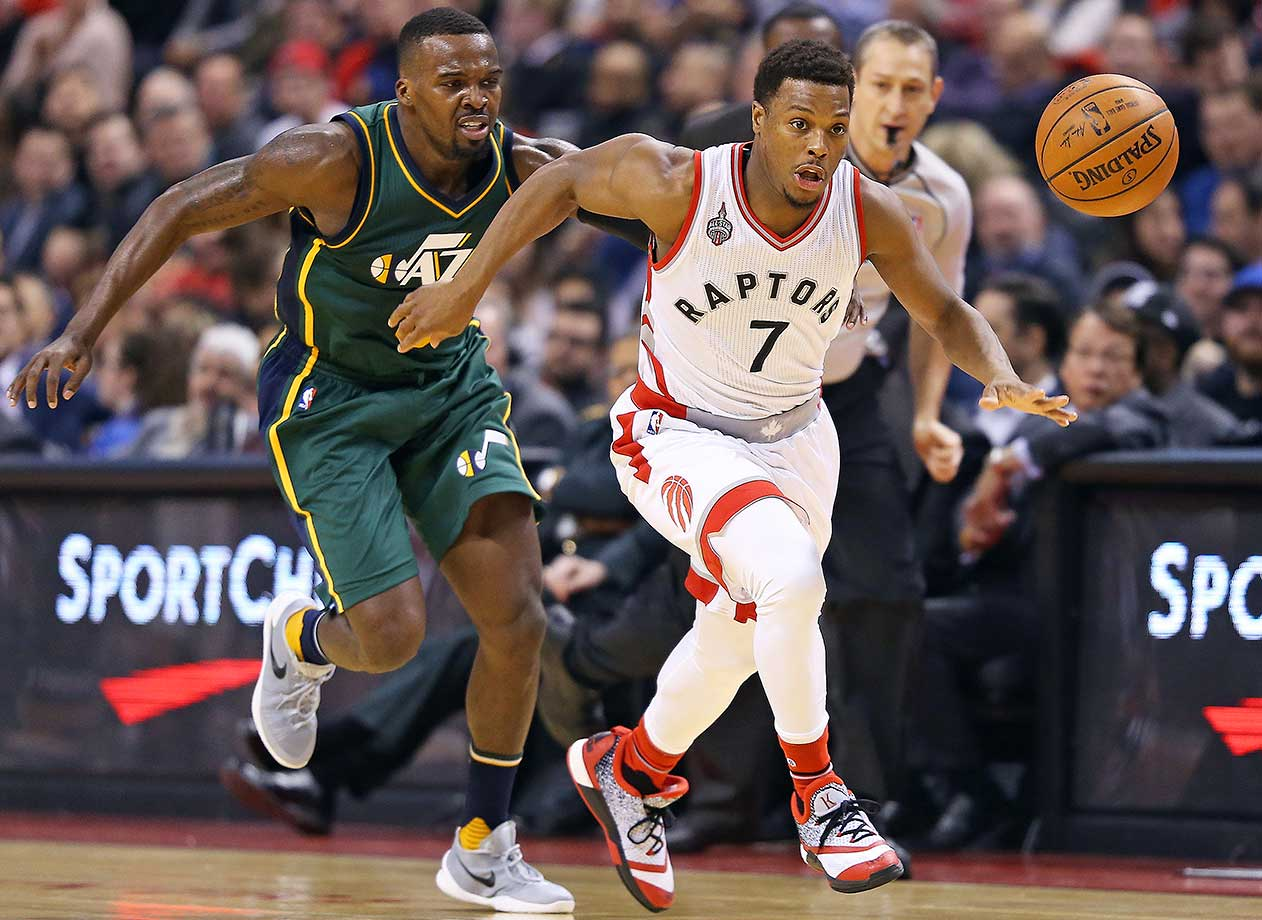 Kyle Lowry of the Toronto Raptors steals the ball and goes in for a basket against Utah.