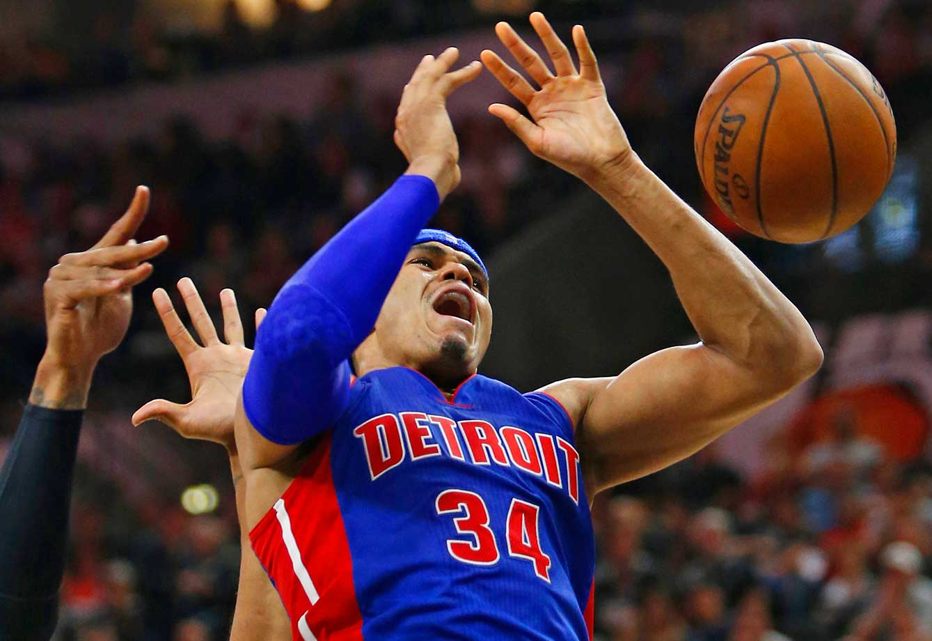 Tobias Harris of the Detroit Pistons has the ball knocked out of his hands by a San Antonio player.
