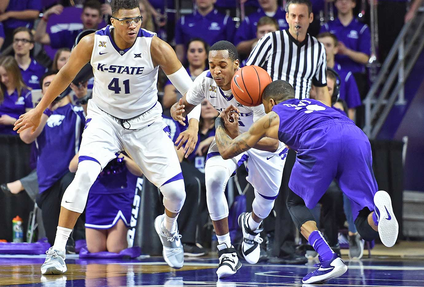 Guard Barry Brown of Kansas State goes after a loose ball against Malique Trent of the TCU Horned Frogs.